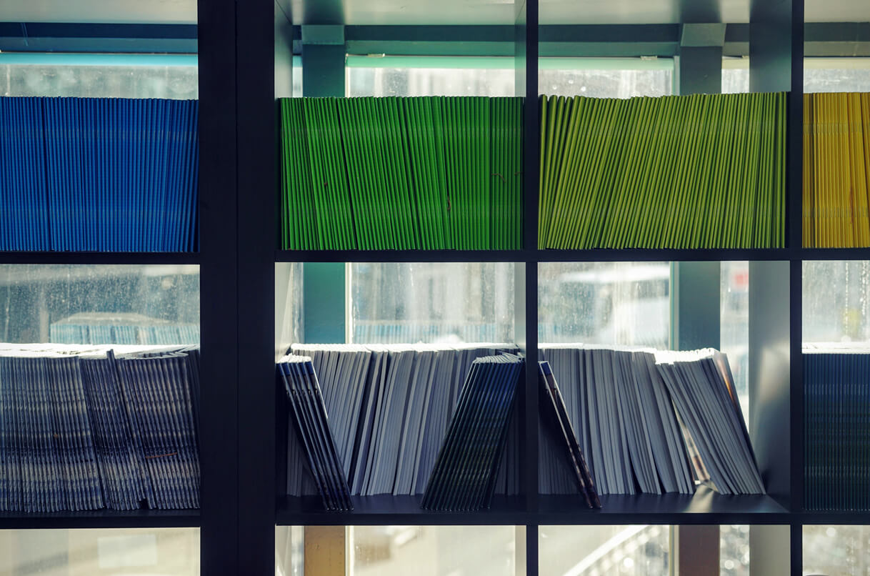 A shelf with colored magazines
